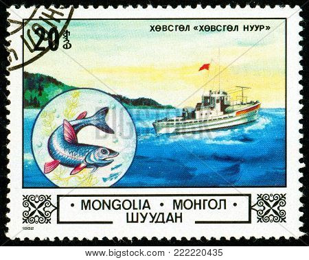 Ukraine - circa 2018: A postage stamp printed in Mongolia shows Fish and boat. Series: Animals and landscapes. Circa 1982.