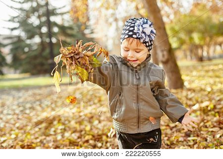 Children Walking In Autumn Park. The Autumn Came. Children Have Fun Playing And Relax In Nature. Gol