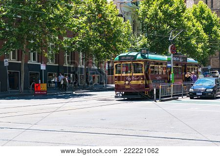 Melbourne, Australia - December 7, 2016: Historic City Circle route 35 tourist tramway on intersection