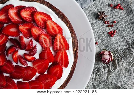 Traditional strawberry pie or tart, cake sweet pastry. classic American food on rustic table background. eating with a custard cream. Top view, rustic style, copy space. Homemade Fresh baked delicious