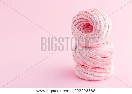 Pink homemade zephyr or marshmallow isolated on white background. Marshmallow, Meringue, Zephyr