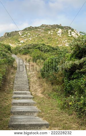 View of long flight of steps to the Ling Kok Shan hill at the Lamma Island in Hong Kong, China.