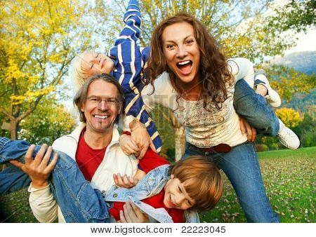 family time - playful family in the park