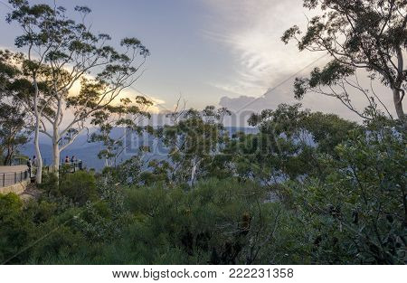Sydney, Australia - Apr 18, 2017: Visitors enjoying the view on the distant Spooners Lookout that overlooks Jamison Valley. Katoomba, Blue Mountains National Park - UNESCO Heritage Site.