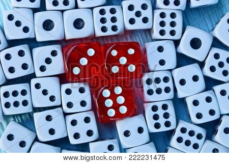 red cubes and white dice on the table