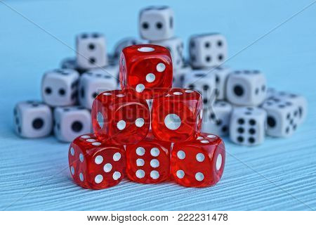 a hill of red dice on the background of small white cubes