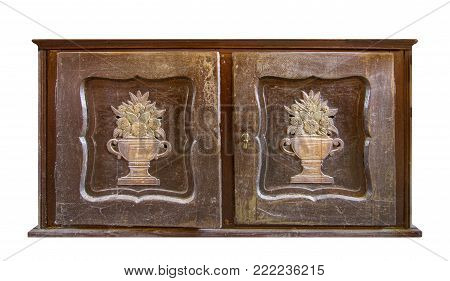 Very old wooden decorated commode on white background