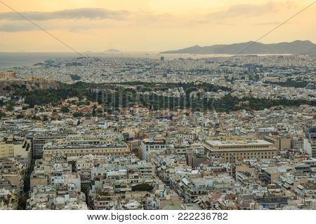 Evening cityscape of Athens, with the pink sky at sunset.