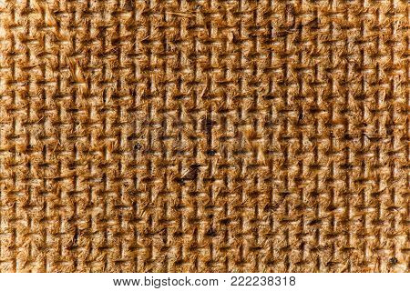 Fiberboard texture pattern, brown abstract background. Rough side of a piece of hardboard light vignette