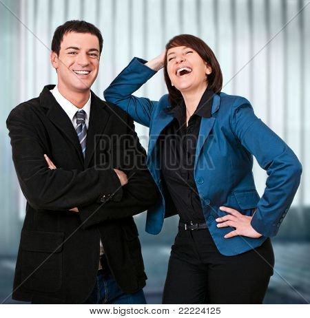 friendly businessteam is laughing into the camera