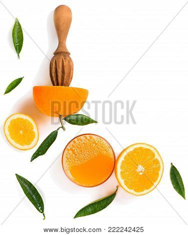 Top view of orange slices, wooden juicer stick and glass of juice of orange isolated on white background.