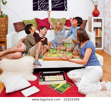 a young family is playing board-games in their bed poster