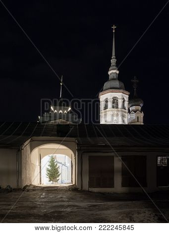 Historical Gostiny Dvor in Suzdal at night. An ancient arch in the shopping arcades with night illumination. The belltower of the Resurrection Church. Suzdal, Vladimir Region, Russia. Gold ring. poster
