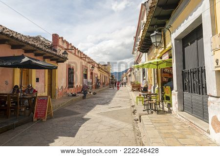SAN CRISTOBAL, MEXICO - NOVEMBER 28: A colonial style street with side walk cafe's and unidentified people on November 28, 2016 in San Cristobal. San Cristobal de las Casas is a popular tourist destination known for its colonial architecture.