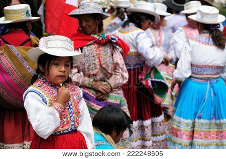 CHIVAY, PERU - 11 DECEMBER 2011: Dancers in traditional dresses on the festival Wititi (UNESCO) in the Chivay town in the Colca canyon
