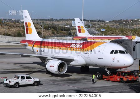 Madrid, Spain - October 20, 2014: Iberia Airline Airbus A319 At Madrid Barajas Airport. Iberia Is Pa