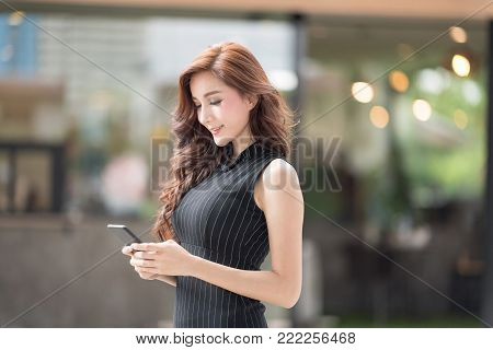 Tired And Unhappy Young Business Woman Using New Technology Gadget Connecting Distance Meeting. Business Freelance Coworking Space Luxurious Serviced Office For Rent Concept.