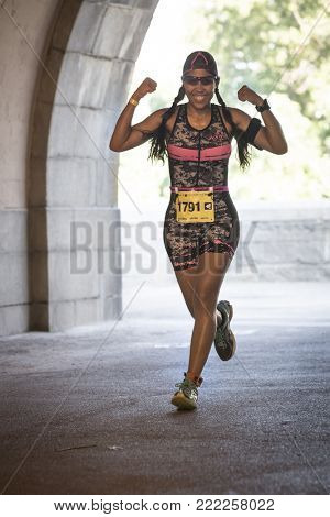 NEW YORK - JULY 16 2017: Athlete runs through Riverside Park during the NYC Triathlon Race in Central Park. The run is 10k and the race is the only International Distance triathlon in NYC.