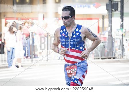 NEW YORK - JULY 16 2017: Athlete runs on West 72nd St during the 10k portion of the Panasonic New York City Triathlon Race, the only International Distance triathlon in NYC.