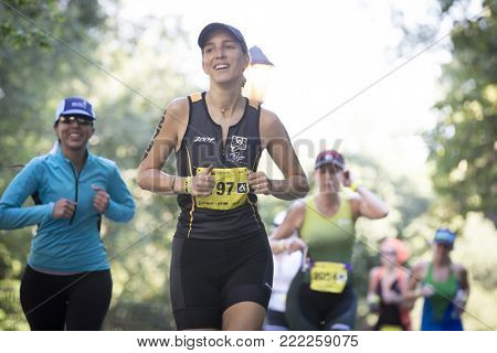 NEW YORK - JULY 16 2017: Athletes run through Riverside Park during the NYC Triathlon Race in Central Park. The run is 10k and the race is the only International Distance triathlon in NYC.