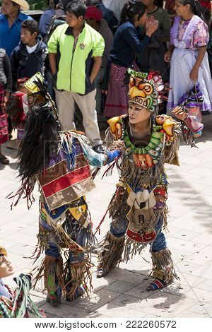 San Juan Ostuncalco, Guatemala - June 24: Traditional Dance Done By Locals With Elaborate Costumes A
