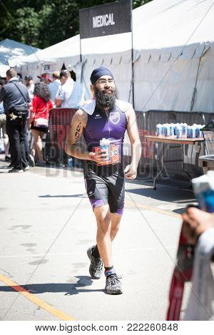NEW YORK - JUL 16 2017: An athlete cools down after finishing the NYC Triathlon Race in Central Park. The run is 10 kilometers and the race is the only International Distance triathlon in the city.