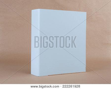 A blue ring binder on beige background