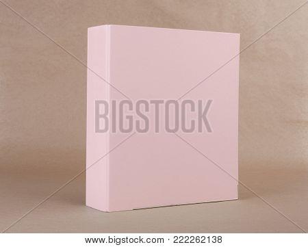 A pink ring binder on beige background.
