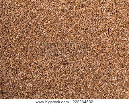 Texture background. Natura coriander powder Top view