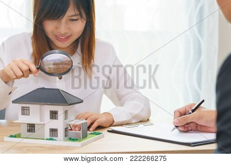 Smile woman searching for new home or inspecting homes before buying with sale man