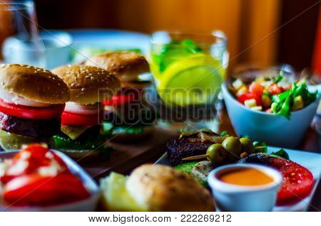 Mini Burgers With Meat, Vegetables, Cheese And Other Toppings, Bread Sprinkled With Sesame Seeds, Mi