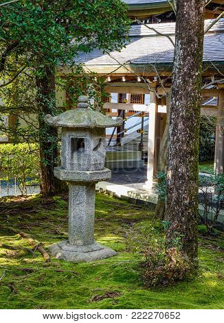 Kyoto, Japan - Dec 26, 2015. A traditional lantern at zen garden of Ryoanji Temple in Kyoto, Japan. Ryoanji Temple is the site of Japan most famous rock garden.