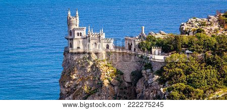 Panoramic view of the castle Swallow's Nest on the rock over the Black Sea in Crimea, Russia. This castle is a symbol of Crimea.