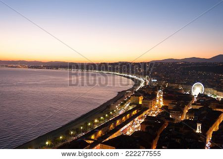 Nice beach night landscape, France.  Nice beach and famous Walkway of the English, Promenade des Anglais. Famous French touristic town