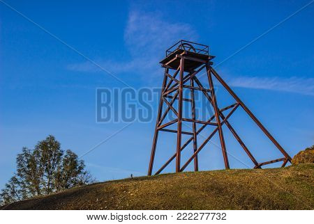 Vintage Iron Mining Tower With Platform On Hillside