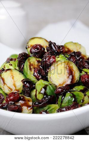 Salad from Brussels sprouts with dried cranberries under balsamic sauce