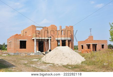 Building residential construction house  from bricks. Unfinished House Construction.