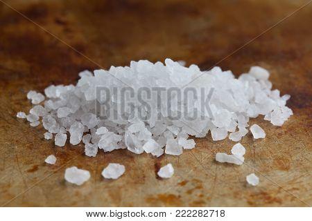 Himalayan Halite salt condiment macro view. Natural mineral flavoring food preservative, Saline sodium chloride white crystal.