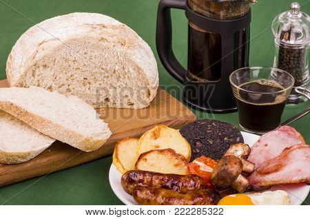 Large Ulster Fry breakfast with Fried Potato (known as Pan Haggerty) or all-day breakfast, a selection of fried breakfast food often served with Sourdough bread and hot fresh coffee.