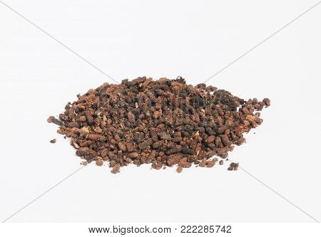 Pile of black land brown fertile soil isolated on white background. Humus compost granules.