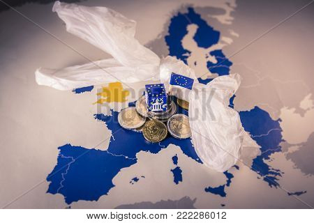 EU map with euro coins and a plastic bag symbolizing european environmental tax regulation.The European Union plans to propose a tax on plastic bags and packaging in the interest of the world's oceans