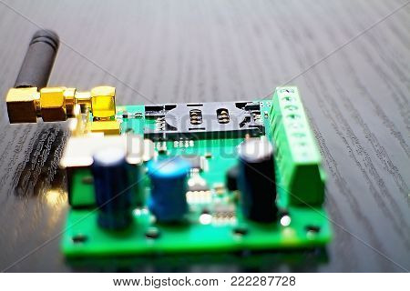 Connector for inserting a SIM card. SIM card holder as part of GSM communicator with antenna.