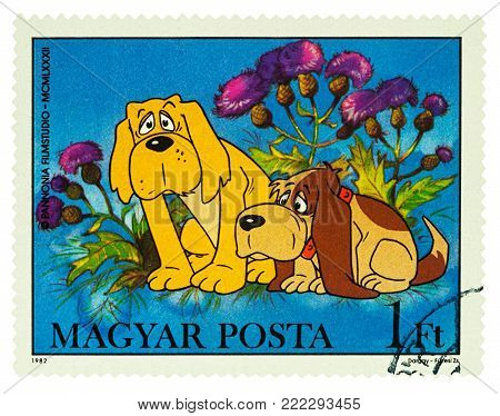 Moscow, Russia - January 16, 2018: A stamp printed in Hungary shows two dogs, series