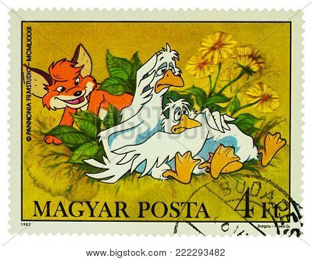 Moscow, Russia - January 16, 2018: A stamp printed in Hungary shows two geese and little fox, series