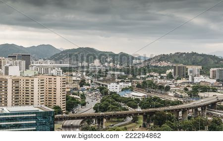 Busy highway junctions in Rio de Janeiro, Brazil. Iconic Maracana stadium is visible on far left of frame poster