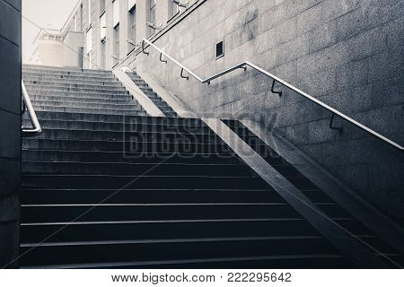 Empty dark underground pass and concrete stairs in the city