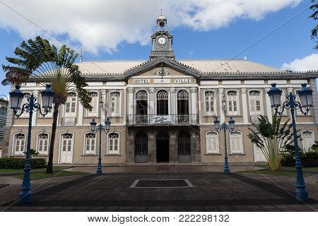 FORT-DE-FRANCE, MARTINIQUE - JANUARY 4, 2018 - The ancient town hall of Fort-de-France and Aime Cesaire theater. Fort de France is the capital of Martinique island, Lesser Antilles