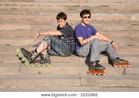 Two Rollers Sit On The Stairs