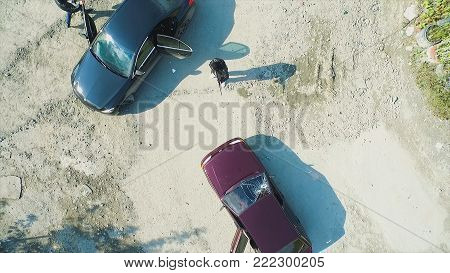 Aerial View On Robbers With Guns Shot The Car And Leave. Terrorist Or Car Thief Pointing A Gun At Th