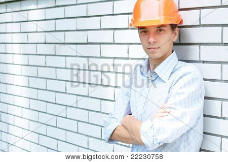 Worker standing near a wall